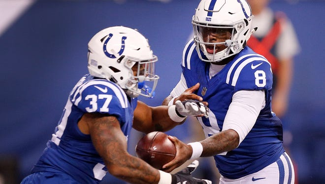 Indianapolis Colts quarterback Phillip Walker (8) hands the ball off to running back De'Mard Blackmon (37)) in the second half of their preseason football game Thursday, August 31, 2017.