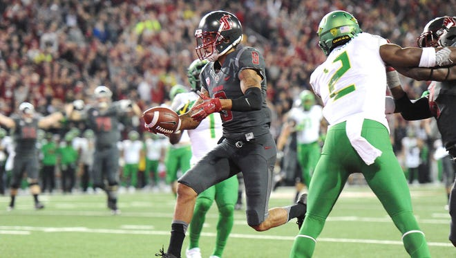 Oct 1, 2016; Pullman, WA, USA; Washington State Cougars wide receiver Gabe Marks (9) runs the ball in for a touchdown against the Oregon Ducks during the first half at Martin Stadium. Mandatory Credit: James Snook-USA TODAY Sports