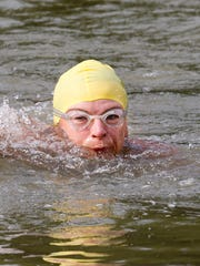 Rhonda Curry swims in the Ohio River a couple of times