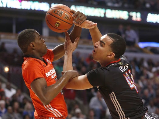 McDonald's East All-American Isaiah Whitehead, left, fouls McDonald's West All-American Trey Lyles during the first half of the McDonald's All-American boy's basketball game Wednesday, April 2, 2014, in Chicago .  (AP Photo/Charles Rex Arbogast)