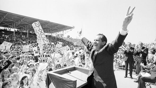 In this Sept. 19, 1968, photo, then-presidential candidate Richard Nixon flashes the victory sign as he acknowledges cheers from the crowd, at the fairgrounds of Springfield, Mo. Theres little doubt Nixon was up to dirty tricks before his presidency ever began. Documents released by the Nixon Presidential Library add weight to existing evidence that his 1968 presidential campaign tried to sabotage Vietnam peace talks before the U.S. election.