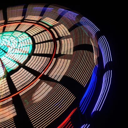 The Seattle Wheel ride at night at the Williamson County