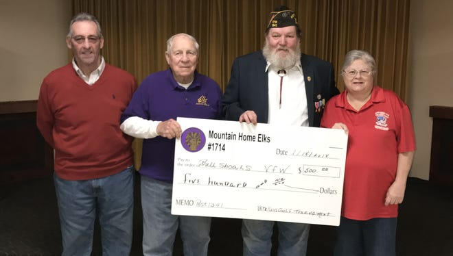 The Mountain Home Elks Lodge recently donated $500 to the Bull Shoals VFW Hoevel-Barnett Post 1341 Veterans Relief Fund. The funds came from the annual Elk's Veterans Golf Tournament proceeds. Participating in the donation were: (from left) Clint Gunderson, and Albert Underwood, Elk members; Charles Kinler, VFW commander; and Cathy Underwood, Elks Veterans Services chair.