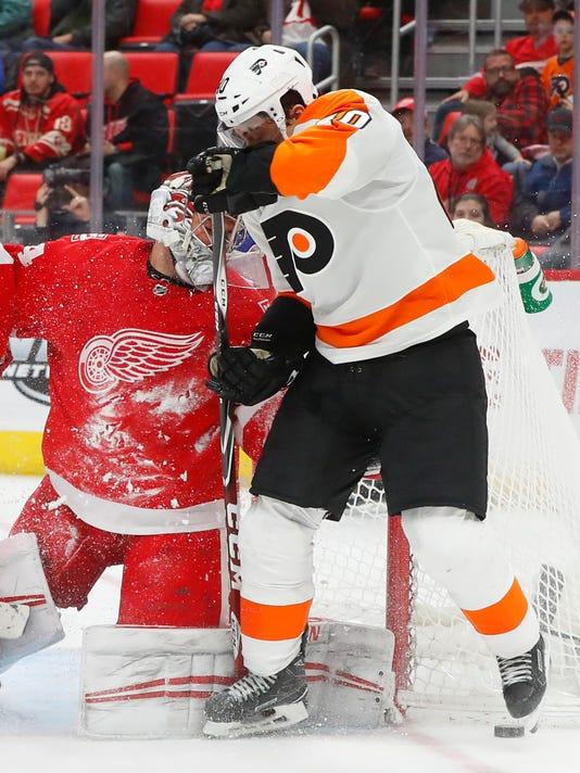 Detroit Red Wings goaltender Petr Mrazek (34) stops a Philadelphia Flyers center Jordan Weal (40) shot in the third period of an NHL hockey game Tuesday, Jan. 23, 2018, in Detroit. (AP Photo/Paul Sancya)