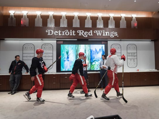 Red Wings players walk to the locker room at Little
