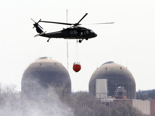 A Blackhawk helicopter flies by Indian Point as it takes part in water bucket training in the Hudson River off Peekskill in 2014. The helicopters are with the New York Army National Guard and were working out of Camp Smith in Peekskill.