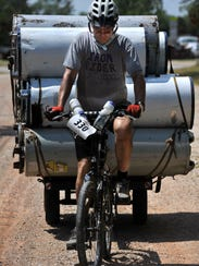 Going slow, John Klemp tests out his load of 12 water