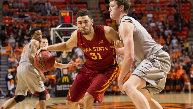 Iowa State Cyclones forward Georges Niang (31) fights for position against Oklahoma State Cowboys forward Mitchell Solomon (41) during the first half at Gallagher-Iba Arena.
