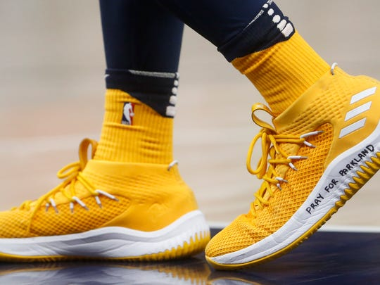 """Utah Jazz guard Donovan Mitchell, a former University of Louisville player, wears a shoe with """"Pray for Parkland"""" written on it, during the second half of the team's NBA basketball game against the Phoenix Suns on Wednesday, Feb. 14, 2018, in Salt Lake City."""