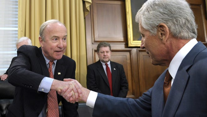 U.S. Rep. Rodney Frelinghuysen, left, R-N.J., chairman of the House Appropriations subcommittee on defense, shakes hands with Defense Secretary Chuck Hagel, right, prior to Hagel's testimony on the Defense Department's fiscal 2015 budget on Capitol Hill in Washington.