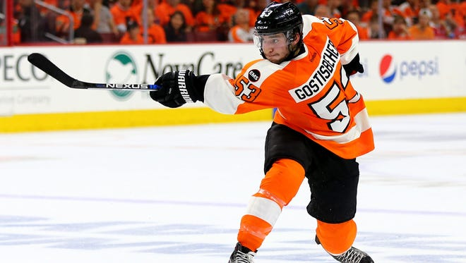 Shayne Gostisbehere finished fifth among rookies in scoring. He is a finalist for the Calder Trophy that will be awarded next month.