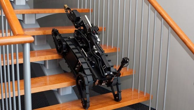 A police robot,similar to a model the Fond du Lac Police Department plans to buy this year, climbs stairs during a demonstration.