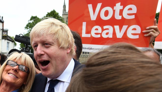 In this Wednesday, June 22, 2016 file photo, advocate to exit Europe Boris Johnson poses for a selfie photo with voters.