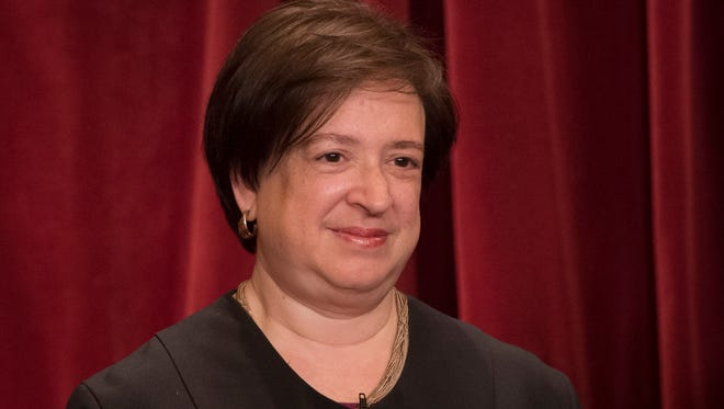 Associate Justice Elena Kagan poses for a group photo June 1, 2017 with all nine Supreme Court Justices in the East Conference Room of the Supreme Court Building.