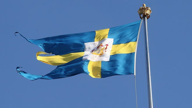 The Swedish flag flies over the Royal Palace on June 7, 2013 in Stockholm, Sweden.