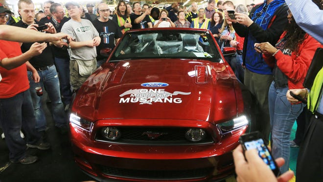 Flat Rock Assembly Plant with the ruby red 2014 Mustang convertible that was the one-millionth Ford Mustang built at  the Flat Rock assembly after an event marking the milestone in April  2013.
