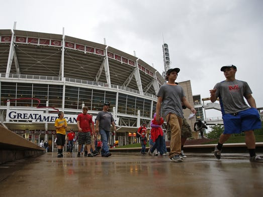 Fans leave after the Cincinnati Reds-San Diego Padres game was postponed at Great American Ball Park Wednesday.