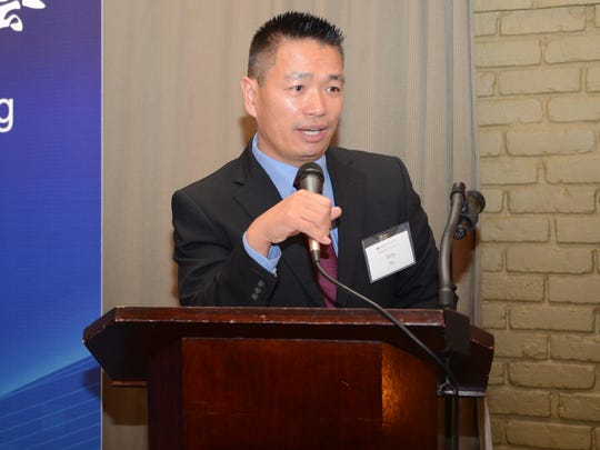 Jerry Xu, president of Detroit Chinese Business Association,  speaks at the group's Oct. 26, 2016 meeting in Bloomfield Hills