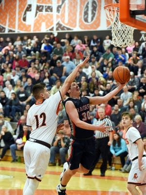 Morgan's Marty Sidwell drives for a basket against Parker Black during the second half of the Raiders' 65-61 loss to Meadowbrook in a Division II sectional final at The Corral. Sidwell scored a team-high 20 points.