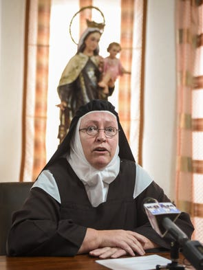 Mother Superior Dawn Marie speaks during a press conference