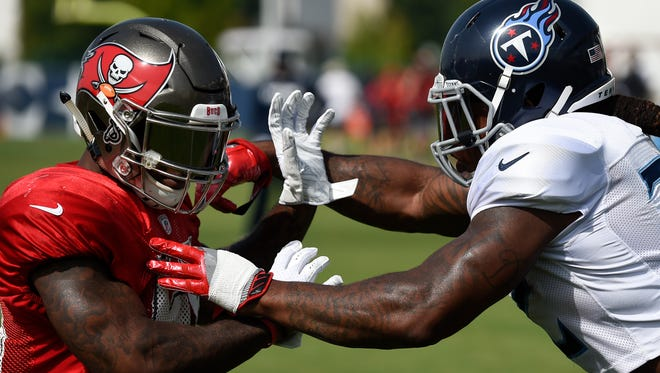 Buccaneers outside linebacker Kwon Alexander (58) is stopped by Titans running back Derrick Henry (22) during pass rush drills during a joint practice at Saint Thomas Sports Park Wednesday, Aug. 15, 2018, in Nashville, Tenn.