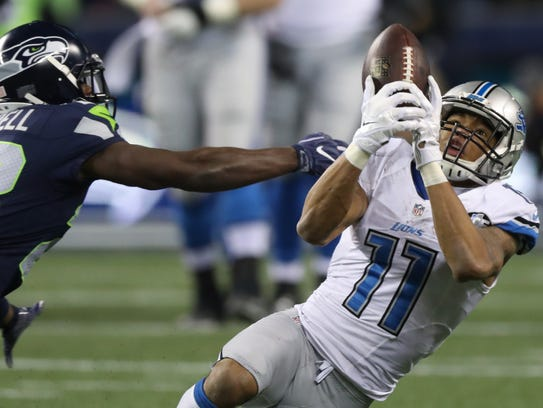 Lions receiver Marvin Jones is defended by Seahawks