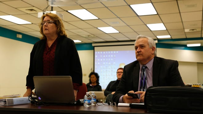 Attorney Eleanor K. Bratton speaks on behalf of Central Consolidated School District Superintendent Don Levinski, seated, Tuesday during Levinski's discharge hearing at the Shiprock boardroom for the Central Consolidated School District.