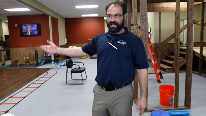 Tim Cousen, Apex Network Physical Therapy clinic manager, talks about his company's services on Monday in Bloomfield.