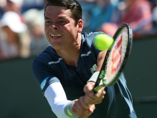 Milos Raonic hits a shot during his loss to Roger Federer at the BNP Paribas Open, Saturday, March 21, 2015.