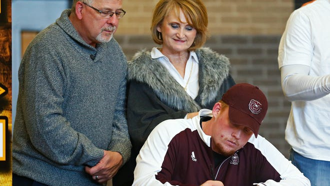 Grant Martin signs a national letter of intent to play football at Missouri State University during a National Signing Day ceremony held at Kickapoo High School in Springfield, Mo. on Feb. 1, 2017.