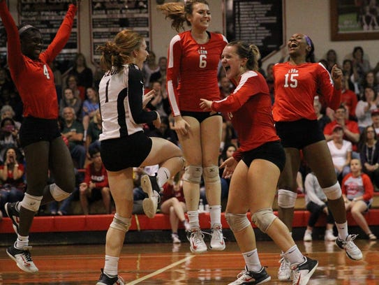 Leon volleyball players Shania Cromartie, Kate Powell,