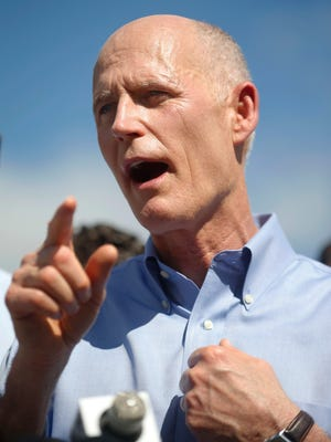 Florida Gov. Rick Scott gestures as he speaks during a news conference about the shooting the day before at Marjory Stoneman Douglas High School, Thursday, Feb. 15, 2018, in Parkland, Fla. Nikolas Cruz is accused of opening fire Wednesday at the school, killing more than a dozen people and injuring several.
