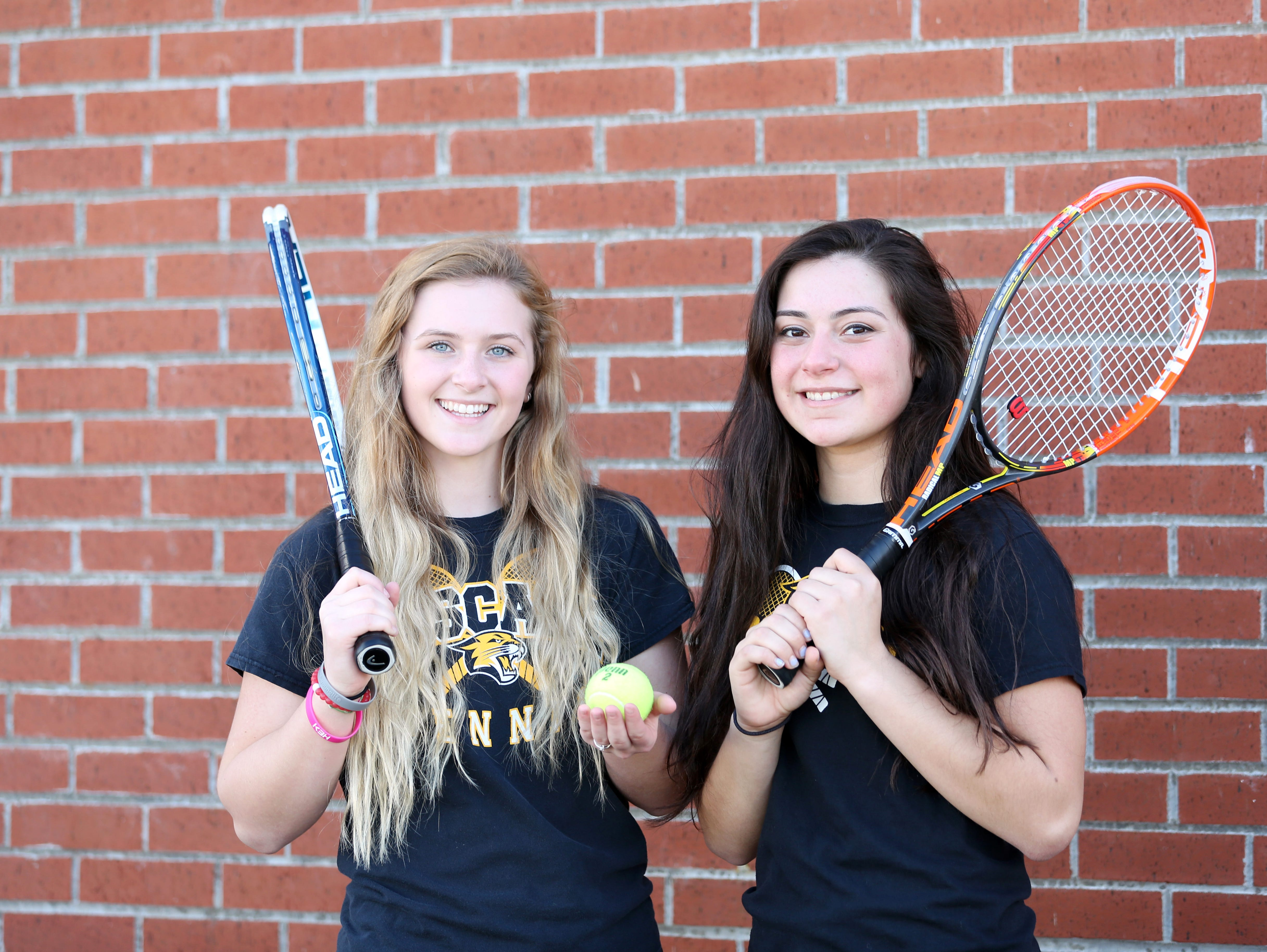 Doubles team Tori Lewis, left, and Jaja Osuna Sola are photographed during practice on Tuesday, March 21, 2017, at Cascade High School in Turner.
