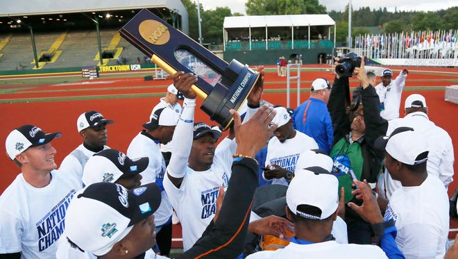 Florida celebrates winning the men's team title at the NCAA outdoor track and field championships in Eugene, Ore. on Friday, June 10, 2016.