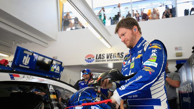 Fans watch from the catwalk above as Dale Earnhardt Jr. and crew work on the No. 88 car at Las Vegas Motor Speedway.