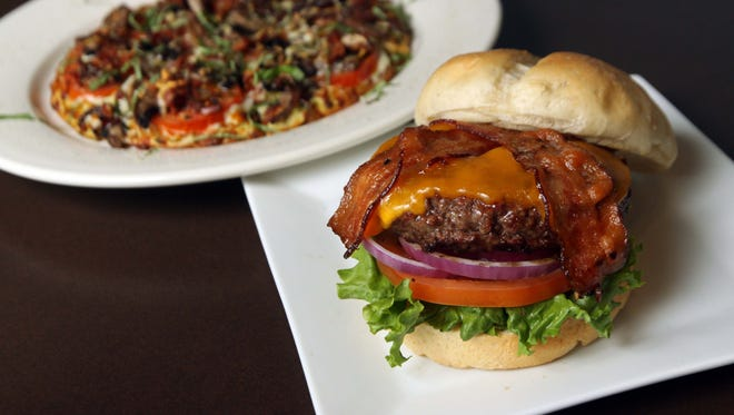 The bacon cheddar burger and Haight-Ashbury pizza at The Grotto in Springfield.