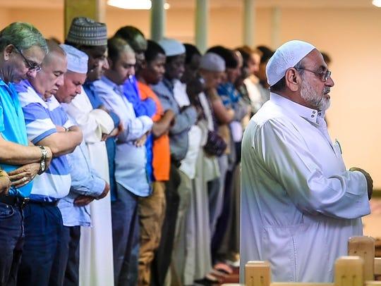 Mahmoud Hayyat of Middlebury leads prayers at the Islamic