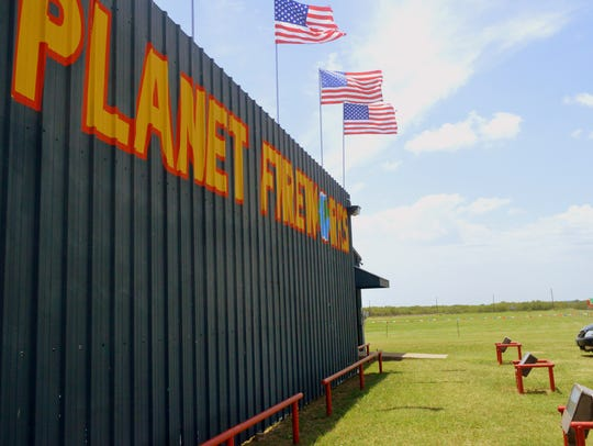 A pasture lies to the west of Planet Fireworks on U.S.