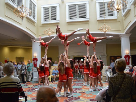 The cheerleading squad entertained residents at a preseason pep rally at the community center.