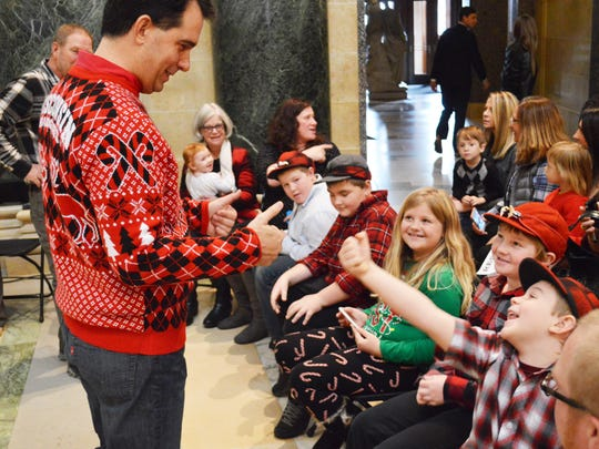 Governor Scott Walker chats with members of the Ryf family prior to lighting the Capitol's 100th Anniversary Christmas tree at the Wisconsin State Capitol. The Ryf family of Price County donated this year's Christmas tree.