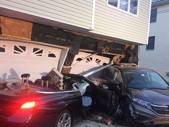 Linden Police and Fire departments responded to the 100 block of Woodlawn Avenue on a report of a motor vehicle collision involving a house.