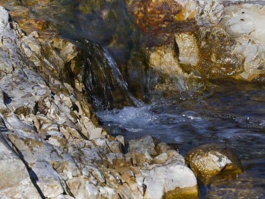 Water gushes down Roark Creek at Ozark Mountain State