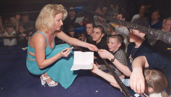 "Tammy ""Sunny"" Sytch of the WWE sign autographs for"