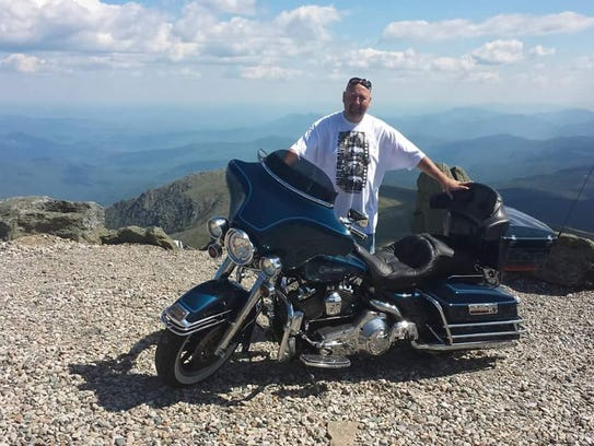 Eric Leopold of Nanuet stand with his Harley Davidson