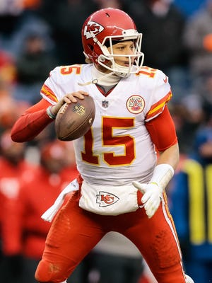 Kansas City Chiefs quarterback Patrick Mahomes (15) drops back to pass in the third quarter against the Denver Broncos at Sports Authority Field at Mile High. Mandatory Credit: Isaiah J. Downing-USA TODAY Sports