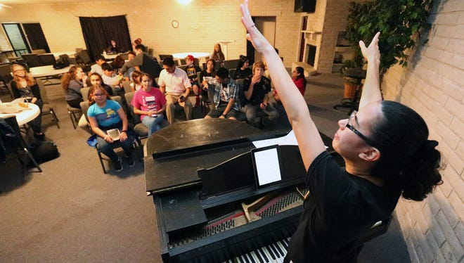 "Music director Laura Sambrano, foreground, leads the cast of Kids-N-Co. in a song for the musical ""Rodgers and Hammerstein's Cinderella"" during a rehearsal in 2016 at Bethel Family Ministries at 6301 Alabama Ave."