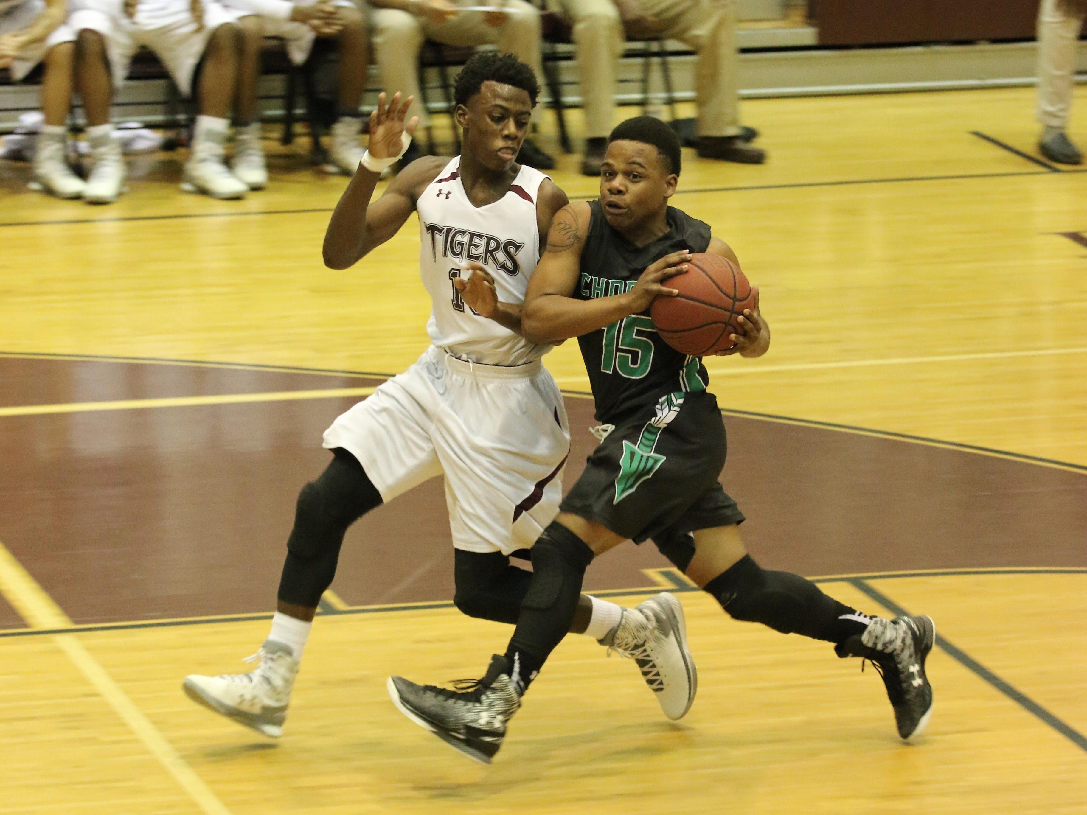 Choctaw's D'eddrick Rodgers, right, works to get past Pensacola's Zykereyan Jones Tuesday night during the Region 1-6A semifinal game at Pensacola High School.