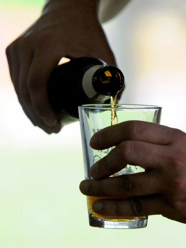 Beer pouring into glass.