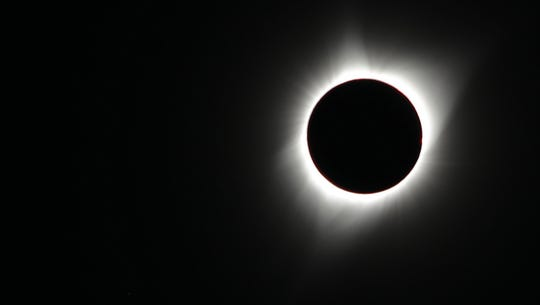 The moon blocks the sun during a total solar eclipse