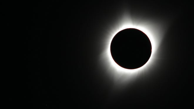 The moon blocks the sun during a total solar eclipse on Aug. 21, as seen from Sunnydell, Idaho.
